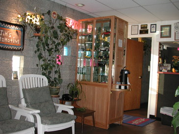 Jim's Automotive - Comfy waiting room with a warm inviting atmosphere.