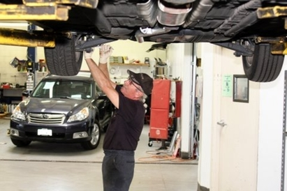 Addison Auto Repair & Body Shop - Erich Sikes on one of our ASE Master technicians.  He is methodical and thorough and makes sure your repair problem is solved.