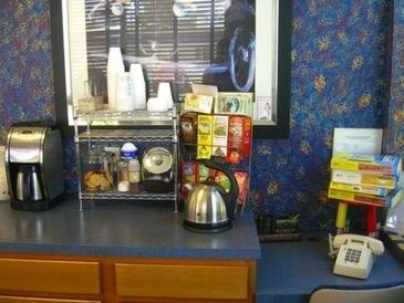 Addison Auto Repair & Body Shop - Enjoy a cup or tea or coffee and fresh baked cookies with a current magazines, while you wait!