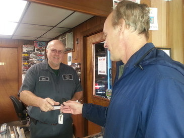 CSE Automotive - Owner Bill Sherwood conversing with happy customer, Brian, owner of a 1970 Plymouth Satellite wagon