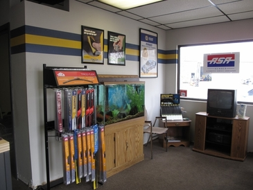 SAF-T Auto Centers - Comfortable waiting area with a great fish tank