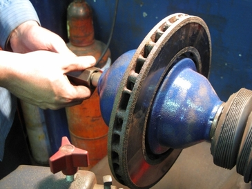 SAF-T Auto Centers - Setting up the brake lathe to machine the rotor for the perfect brake job