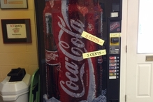 Lowell's Independent Automotive   Scion, Lexus, Toyota - Our famous 5-cent Coke machine. We're pretty sure you haven't seen prices like ours in over 50 years. That's a classic pedal car on top of the machine.