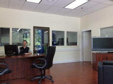 "XDealerTechs - Our office-Waiting area with a 42"" tv, Wi-Fi, coffee and soda available to provide you with a comfortable experience"