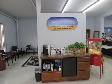 Phil's Pro Auto Service - The snack bar with popcorn, cookies, coffee and water is always open.