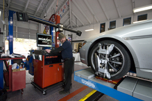 Theo's Automotive, Inc. - Scottie, my right hand man with long experience ASE certified performing a wheel aligment on the latest laser  four wheel alignment machine from HUNTER (HawkEye). THIS IS THE BEST THAT MONEY CAN BUY.