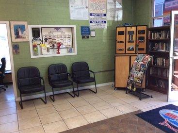 Leo's Auto Repair - Customer waiting area with magazine rack as well as fully stocked bookshelf.