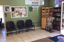 Leo's Auto Repair - Customer waiting area with magazine rack as well as fully stocked bookshelf.