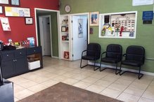 Leo's Auto Repair - Different view of waiting room showcasing complimentary coffee station provided for our customers.