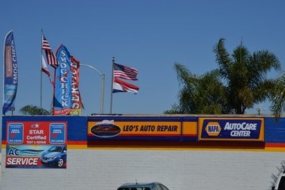 Leo's Auto Repair - Side view of building with our logo as seen from the intersection of PCH and Walnut.