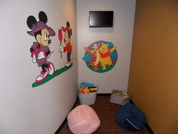 Victory AutoCare & Tire Center - Our children's play area has games, books and a separate TV showing popular children's movies and programs.