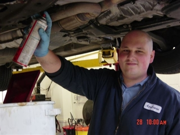 Auburn Foreign & Domestic - Andrew changing oil