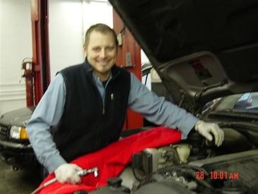 Auburn Foreign & Domestic - Troy servicing a car