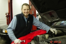 Auburn Foreign & Domestic - Troy servicing a car