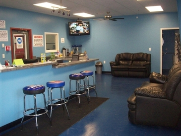 Affordable Auto Clinic - Relax in our modern waiting room. Enjoy a cup of coffee, watch our big screen tv, or bring your laptop, we're WiFi. Shadow(office dog) our greeter would love to see you.
