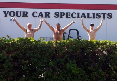 Your Car Specialists - A Little Fun While Putting Up The New Sign