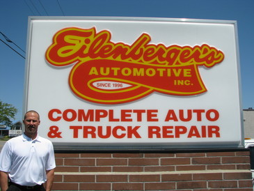 Eilenberger's Automotive - Paul Eilenberger in front of Marquis sign