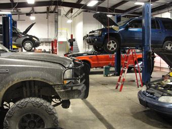Gary Johnston Automotive Service - MEN AT WORK!  We work on everything from Diesel engine pickups to gas powered cars both foreign and domestic.