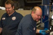 Greg's Garage - Jeff W. & George H. providing maintenance and European repair.