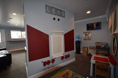 "Leo & Son Garage Inc - New Kids play area inside ""Leo's Lounge"".  Coloring, legos, games, puzzles, dedicated TV"