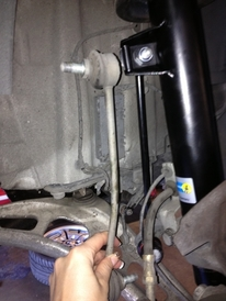 Prestige Auto Works - BMW 330 bent stabilizer link next to new link and new strut.