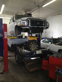 Carracino's Auto & Truck - One of our very skilled techs pulling the cab off of this 2005 f350 diesel to preform performance upgrades and change the headgaskets. We can do anything at Carracino's
