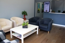 THE Auto Shop - The waiting room has free wifi, phone charging stations, coffee and alkalized water