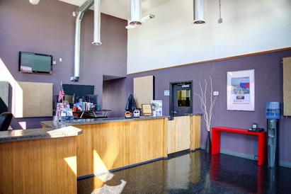 """Larrondo's Auto Center - Welcome to our lobby! We love the """"industrial"""" look - and have given much thought to a lobby that uses minimal resources (such as lights and power) and represents our brand - fun, fresh, professional"""