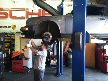 R & D Motorsports - Oscar hard at work on a 911.