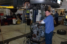 Country Auto Care & Tire Center - No job too big. Here is one of our technicians replacing an engine in a Nissan Maxima