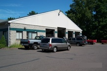 Country Auto Care & Tire Center - Rear view of building. Doesn't look this big from the front.