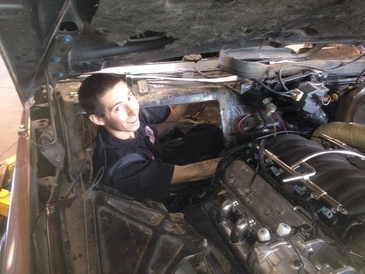 PRK Automotive - Here is Gabe in the dash/engine compartment of  a 79 Cadiallac.