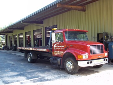 KAMS Auto Service Center - KAMS tow truck on site ready to pick you up!