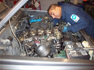A+ Japanese Auto Repair Inc - ASE MASTER CERTIFIED TECHNICIANS - ASE Master Certified Auto Mechanic working on a Toyota Truck.