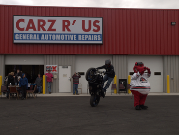 Carz R Us Auto Repair & Tires - This is our 4th Annual Customer Appreciation. This was extra special as it was also the grand opening of our new facility. It included live band, stunt bike, free food, Hammy, tons of kids activities