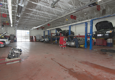Mark's Auto Service - A Look inside our main shop. Their are 2 other rooms where work can be completed, not pictured here. One room has 3 more lifts with our tire equipment, and the other has the alignment machine.