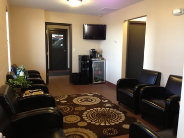 Mark's Auto Service - Clean, comfortable, and cozy waiting room. Includes Free beverages(water, coffee, soda), Wifi, Cable TV, and magazines.