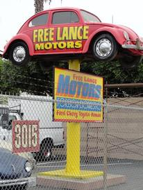 "Free Lance Motors - This VW on the pole is our ""LAND MARK"" IN Long Beach. We started off as a VW specialist, now we work on all make's & models!!"
