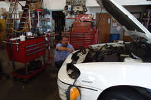 Mike Roy Automotive - Our diagnostic & ac tech Mark tracing an electrical circuit.