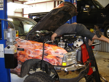 RC Auto Specialists - One time we lost a mechanic for 15 minutes inside a F250 engine compartment.