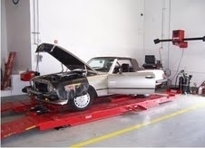 Auto Tech And Body - Computer based wheel alignment machine that performs standard auto maintenance consisting of adjusting angles of the wheels to keep the car moving straight and reducing tire wear.