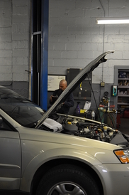 Schnauble Automotive Inc - John working on a car